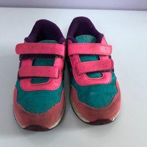 Toddler girl's Adidas tennis shoes.